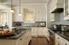 I love kitchens with white cabinets. Also love the second sink in the island.