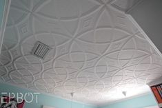 These are Styrofoam ceiling tiles you can glue up right over popcorn ceilings! No prep work required!: