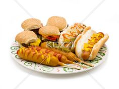 platter of food - Burgers, hot dogs and corn dogs all piled together on a plate