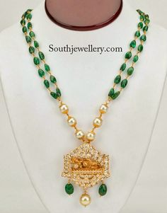 An elegant piece of necklace with double rows of emerald beads joined to south sea pearls chain on either side to which a designer temple pendant studded with uncut diamonds is attached. This necklace is complemented by matching uncut diamond earrings. This necklace is available from Shree Jewellers, USA. For price inquiries contact: info@Shreejewelersusa.com Related