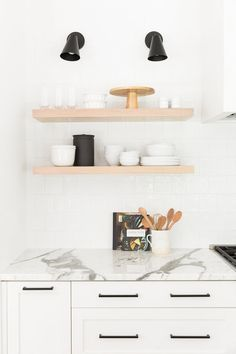 Modern Kitchen Interior Natural wood open shelving styling in a modern white kitchen with leather stools and a thick marble island Modern Kitchen Design, Interior Design Kitchen, Interior Office, Modern Kitchens, Modern Spaces, Kitchen Designs, Interior Styling, Kitchen Shelves, Kitchen Cabinets