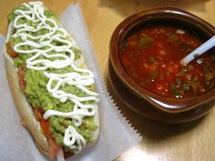 El Completo- dog with sauerkraut, mashed avocado, chopped tomatoes, mayo, red chili sauce