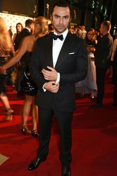 Is Aidan Turner practising his Bond pose?