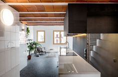 Rediscovered attic space makes room for mezzanine level in Barcelona loft apartment