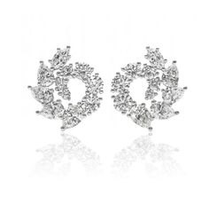 Garland Earrings,      22 round brilliant, marquise and pear-shaped diamonds, approximately 4.80 total carats; platinum setting. Length 17.5mm.