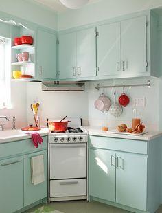 our kitchen. shelves, hanging pots!