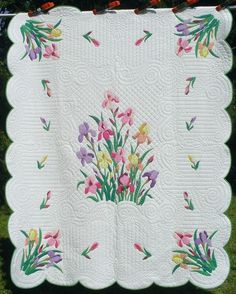 Iris Kit Quilt - have this one - on my bed right now.  Appliqued by great grandma and quilted by paternal grandma.