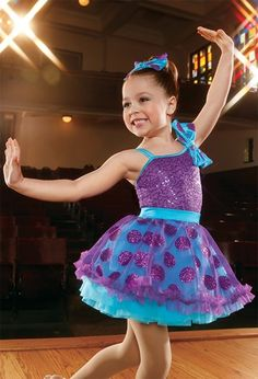 Glittery polka dot tulle and a kiss ruffle trim accent the topskirt of this sweet style from Weissman Costumes:
