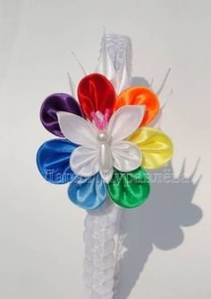 beautiful flower with butterfly made of ribbon...Фото