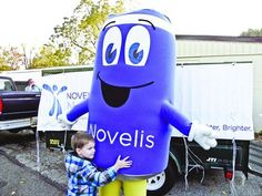 Recycling event, anthropomorphic can helps the needy. Tribune Chronicle - Warren, OH