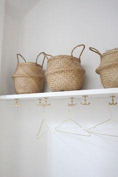 lovely storage idea | white cupboard & gold coat hooks