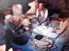 "World breads: An Afghan ""Fournier"" forming, shaping and baking flatbreads using a fire pit oven, Afghanistan. (Photo: Roland and Sabrina Michaud) #realbread"