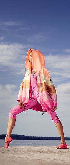 """Instead of """"dressing for the weather"""" and sticking to standard blacks and greys on stormy days, try brightening the mood with a vibrant pink-striped rain jacket from the Bogner Aprés Sport Spring/Summer 2016 collection. See more ready-for-summer looks here soon!"""