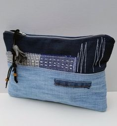 This Unique Denim Canvas Small Purse/Pouch/Clutch is perfect for everyday organizer. This Pouch is one of a kind. It has hand embroidery that compliments the fabrics. The back side of the Clutch bag has Canvas fabric which is a contrast to the dark denim. It has plenty room for Wallet, IPhone, IPod, Kindel or Small tablet. The pouch has a zipper with leather pull up with a tassel. The Clutch/ Purse has two slip pockets inside. It is lined with dark blue silky fabric. it is Perfect Small…