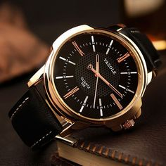 Mens Gold Watch with black or white face. Brown or black band.