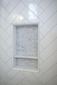 Shower niche. The shower niche features marble mosaic tile. #showerniche #showernichetie shower-niche