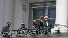 'Very hard sell': Any deal with Iran may face US Congress disapproval http://sumo.ly/88oI  Iranian Foreign Minister Javad Zarif (R) listens to questions from journalists as he stands next to Iran's chief nuclear negotiator Abbas Araghchi (L) and Hossein Fereydoon (2nd L), brother and close aide to President Hassan Rouhani, on the balcony of Palais Coburg, the venue for nuclear talks in Vienna, Austria, July 10, 2015. (Reuters / Leonhard Foeger)