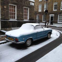 Peugeot 304, under the snow. Islington.