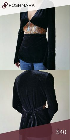 Velvet Tie Back Top Very elegant tie back top made with soft black velvet.   > vintage, not Free People > no trades or non Poshmark transactions  > reasonable offers are accepted Free People Tops