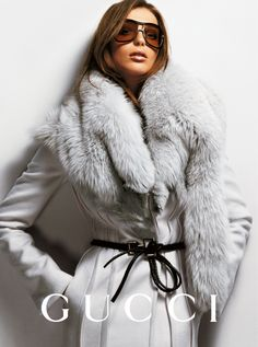 NOT a fan of this girl's face or those awful shades but that coat speaks for itself! and its saying beautiful things!