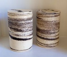Pair of lidded jars, stoneware clays,
