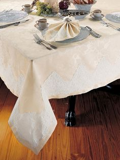 Leilani - Luxury Table Cloths - A lush flowering of Ivory damask basks in the incandescent glow of 500 thread count, 100% pure Egyptian cotton sateen from Italy