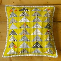 Flying geese cushion - love the colors and the quilting. This would make a nice lap quilt!