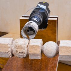 A lathe jig for turning Wooden Balls us a drill. #woodworkingtools