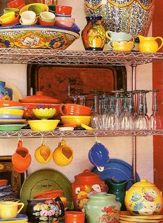 Use wire racks/shelving to store all of your pretty pottery, glassware, etc. out in the open. Gives your kitchen or pantry that 'European' look!