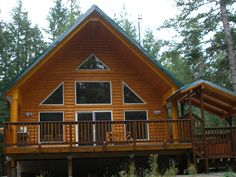 This 3 bedroom, 2 bath log cabin is located in Packwood, Washington, 20 minutes from White Pass Ski Area and Mount Rainier National Park entrance. The all wood handcrafted cabin is fully furnished and comfortably outfitted with central heating and air conditioning, wireless DSL, laundry room with washer and dryer, and private, covered hot tub. #trees #woods #cabin