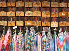 Paper cranes and ema (wooden plaques on which to write wishes) at Shinto shrine Fushimi Inari