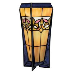 This beautiful Tiffany style table lamp brings charm to any room. Made from stained art glass and bronze, it measures 10 inches high and 4 inches in diameter. Designed for indoor use, the lamp requires a 60-watt bulb and is ideal for most rooms.