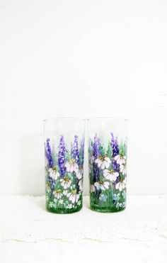 A set of two glass tumblers, water glasses, hand painted in an original design of Scandinavian folk art, my garden design, delphinium, coneflowers, garden flowers. It was hand painted using acrylic enamel paint with colors of purples, mauves, green and white, with a little brown and yellow. Anchor Hocking 15 oz capacit Scandinavian Folk Art, Little Brown, Enamel Paint, Delphinium, Garden Design, Glass Vase, Hand Painted, Anchor Hocking, Tumblers