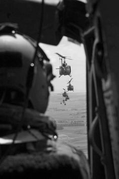 Row of Hueys flying to the landing zone