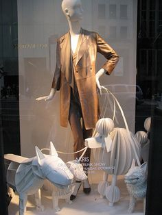 IMG_0458 by justinedori, via Flickr    The paper dog mannequins make this window display eye catching
