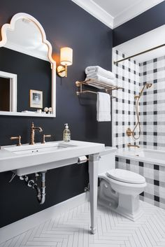 Caitlin Wilson - Because the shower was more visually busy, I kept the floors a bright white in a herringbone pattern for a clean contrast. I love the way the two patterns complement each other in scale and color.