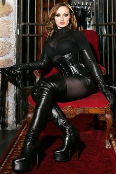She didn't just want to project power; she wanted to personify it. #leather #boots #gloves #corset