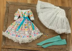 https://flic.kr/p/onUFuY | Colorful Blythe Embroidered Dress Set | Coming tomorrow! 12:30pm central time. This colorful Blythe dress set includes: 1. Dress - This dress is made from a colorful delicate cotton lawn, embellished with french lace, cotton lace, silk ribbon, and a special embroidered bodice. The bodice of the dress is lined and closes with snaps in the back. 2. Petticoat - Made with soft tulle, cotton lace, and lawn. 3. Teal socks - Made with cotton 4. Rainbow necklace - A…