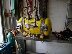 No, its not a time machine. Its a gas powered forge, made from an old air compressor tank. Handy for blacksmithing, or for generally heating chunks of metal up really hot    More homemade shop equipment. - Page 3 - WeldingWeb™ - Welding forum for pros and enthusiasts