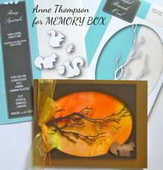 The GRACEFUL OVAL BRANCH die no. 99465 is the focal point for today's cards. It creates such a lovely silhouette when placed over a watercolored background. And I couldn't resist adding one of the BUSY SQUIRRELS from die no. 99394! I die cut the Graceful Branch Oval twice, once from gold cardstock with a wide border and once from a dark brown cardstock with a narrower border. By offsetting them a bit, there's a lovely gold layer that peeks out from behind the dark brown. The watercolor…