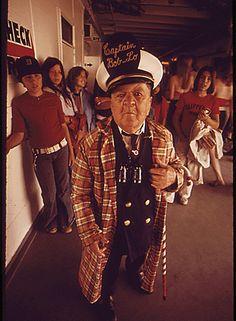Joe Short, aka Captain Bob-Lo, with passengers on a Bob-Lo Steamer cruise. June, 1973.