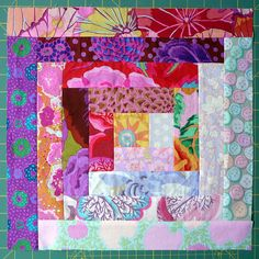 Delicious light and dark quilt square features Kaffee Fassett fabrics.