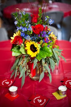 Red_Rose_Berries_Blue_Delphinium_Thistle-Yellow_Sunflower_Fall_Centerpiece