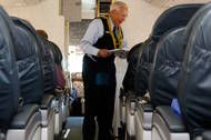 longest serving flight attendant united airlines 83 y.o. Ron Akana