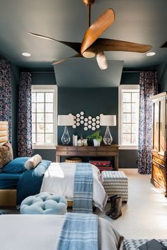 Bold, fresh colors combined with striking patterns create an inviting and youthful space. This stunning bedroom in the HGTV® Smart Home 2018 was painted with Dark Night (HGSW3331). #sponsored