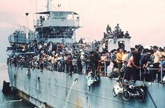 https://flic.kr/p/vmUquz | VUNG TAU 1975 - More than 7,000 refugees jammed the South Vietnamese Navy ship HQ-504 - Nỗi thống khổ và buồn đau ngày 30-4-1975 của nhiều người dân Nam VN. | Jampacked with more than 7,000 refugees, the South Vietnamese Navy ship HQ-504 arrives at Vung Tau port, the South Vietnam' s most popular sea resort, and now the only port city in the Government hands. More than 20,000 Vietnamese refugees including those from Hue and Da Nang arrived at Vung Tau from Cam…