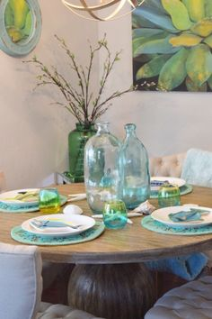 Bring your dining room to the beach with coastal artwork, mirrors, placemats and vases.  Available at HomeGoods.  Sponsored Pin.