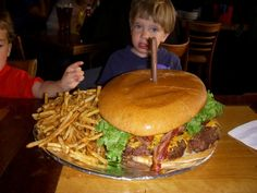 """""""Eye spy with my little eye, a little boy who won't be getting dessert today."""" Insane Burger Eating Challenges and Hamburger Eating Competitions. Crazy Burger, National Burger Day, Food Articles, Eat Pizza, Time To Eat, Fabulous Foods, Meatloaf, Ethnic Recipes, Desserts"""