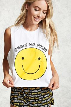 """A PJ set with a knit tank top featuring a """"Show Me Your"""" happy face graphic, a round neck, raw-cut drop armholes, a front patch pocket, along with knit """"Show Me Your Happy Face"""" graphic shorts, an elasticized waist, and dolphin hem."""