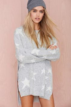 Super cute star sweater. Would be perfect with leggings or jeans.